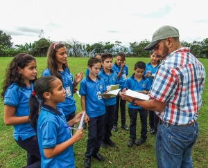 Head Teacher Eugenio Garcia leads students in an outdoor learning exercise. Photo by Alison Olivieri.